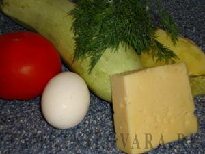 Кабачки, фаршированные овощами и сыром